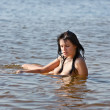 Naked woman in the sea — Stock Photo