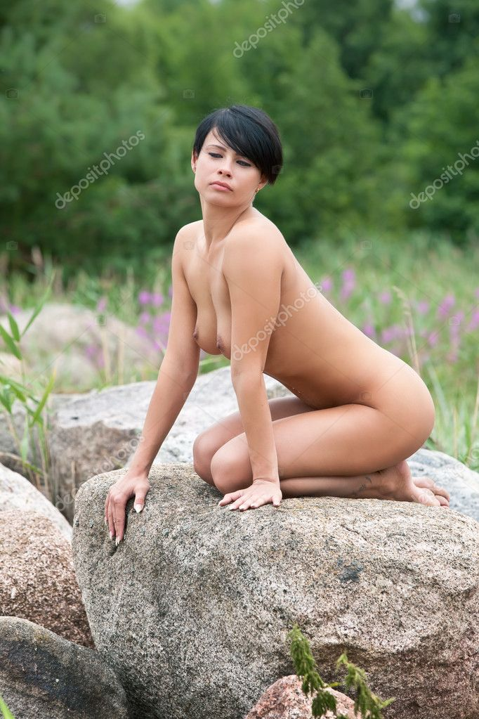 Beautiful Nude Woman Sitting On The Stone Stock Image