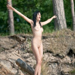 Nude woman with  raised arms — Stockfoto