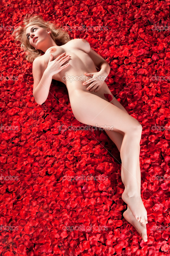 Woman On Bed Of Rose Petals