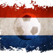 netherland rip flag with football background — Stock Photo #8970312