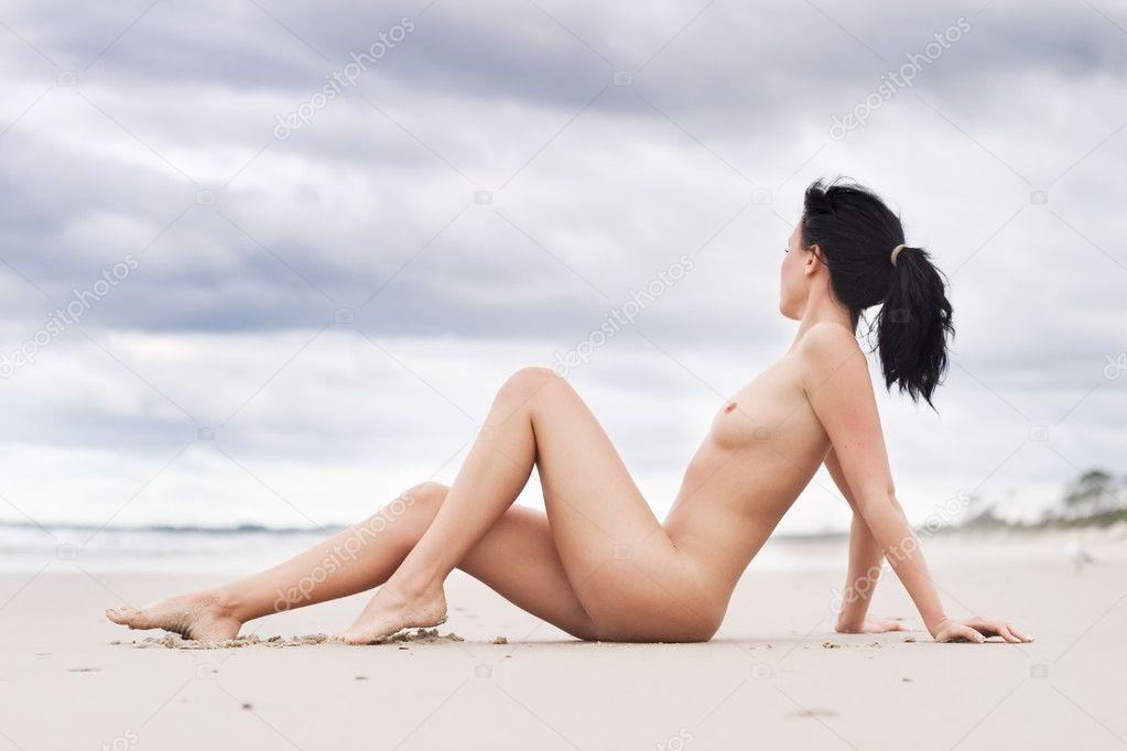 Nude Woman Sitting On Beach Stock Image