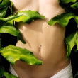 Stock Photo: Anonymous nude in lush green foliage