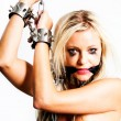 Bondage art style with blond woman cuffed  in chains — Stock Photo