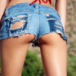 Stock Photo: Tiny denim booty shorts