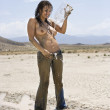 Stock Photo: Topless muddy woman.