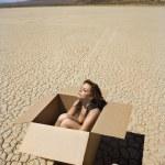 Nude woman in desert. — Stock Photo