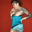 Tattooed woman thinking — Stockfoto