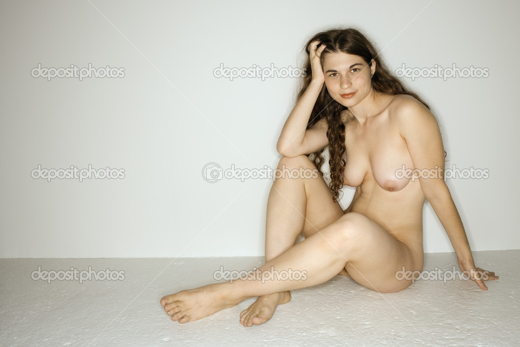 Nude Woman Sitting Stockbeeld