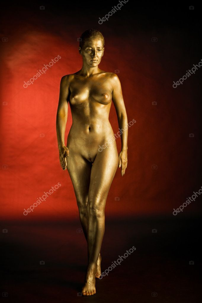 Nude girl bodyart painted in gold on red and black background — Stock Photo #9248512